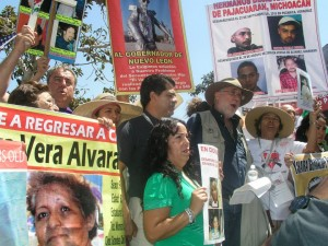 Javier Sicilia and fellow Caravaneros chanting