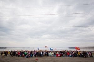 The Healing Walk, at the site of the 4th stop for prayer and ceremony, in front of a giant tailings pond. Photo credit: Ben Powless