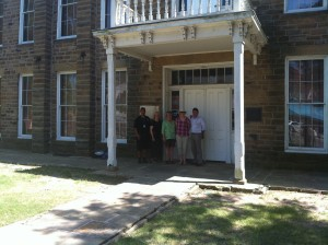 Creek Council House, downtown Okmulgee, OK. GX tour group pictured with Muscogee Nation Museums Director/Curator John Beaver and Assistant Director Justin Giles.