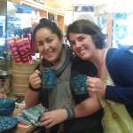 Global Exchange Staff Jessica and Chelsea with Chelsea's new Le Souk dishware.