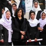 Reality Tour participant with women students in Afghanistan. - Photo by Zarah Patriana
