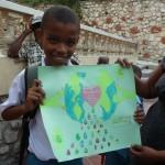 Haitian Boy shows his WAP drawing