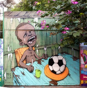 Brazilian artist Paulo Ito created this mural on the doors of a schoolhouse in São Paulo. The image has since gone viral. Courtesy of Paulo Ito. https://www.flickr.com/photos/pauloito/13998946669