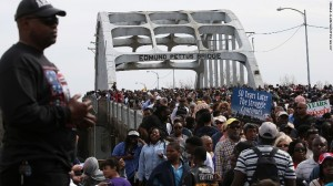 Thousands of people marched across the Edmund Pettus Bridge during the 50th anniversary of the Selma to Montgomery civil rights march. (Photo credit: Justin Sullivan/Getty Images)