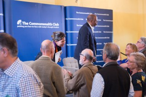 Ms. Serrano greets attendees at the Commonwealth Club.